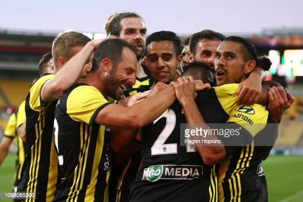 David Williams of the Phoenix celebrates with Roy Krishna and Andrew Durante after scoring a goal during the round 13 ALeague match between the...