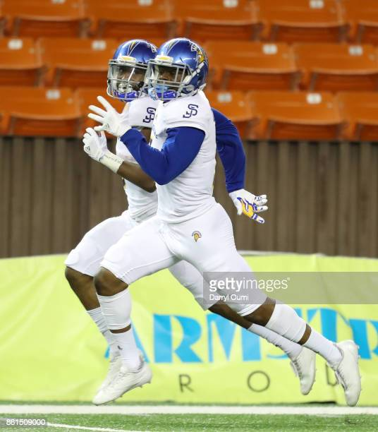 David Williams of the San Jose State Spartans runs stride for stride with teammate Rahshead Johnson as Johnson runs back a kickoff for a touchdown...