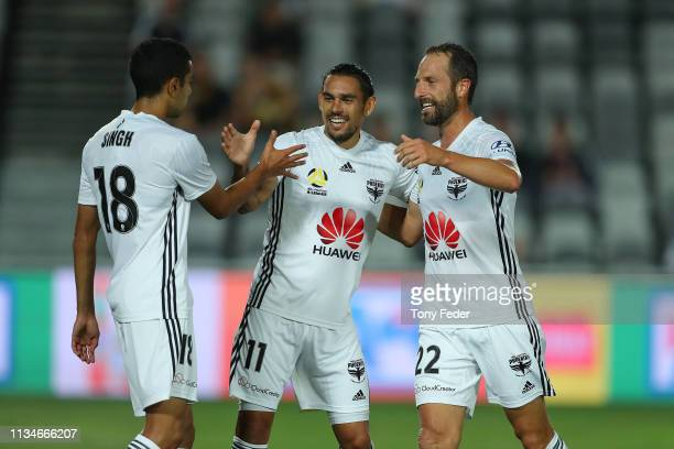 David Williams of Wellington Phoenix celebrates a goal with team mates Andrew Durante and Sarpreet Singh during the round 21 A-League match between...