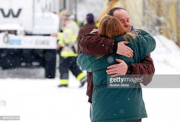 David Wilson of Reading right business owner of Flying High Stables embraces a woman after a partial roof collapse at Flying High Stables trapped...