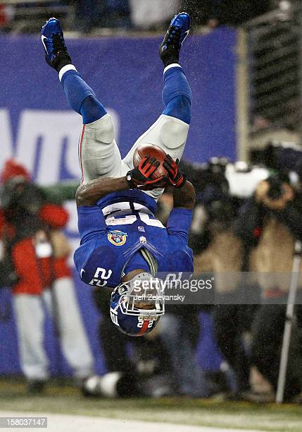 David Wilson of the New York Giants celebrates his third touchdown of a game against the New Orleans Saints at MetLife Stadium on December 9 2012 in...