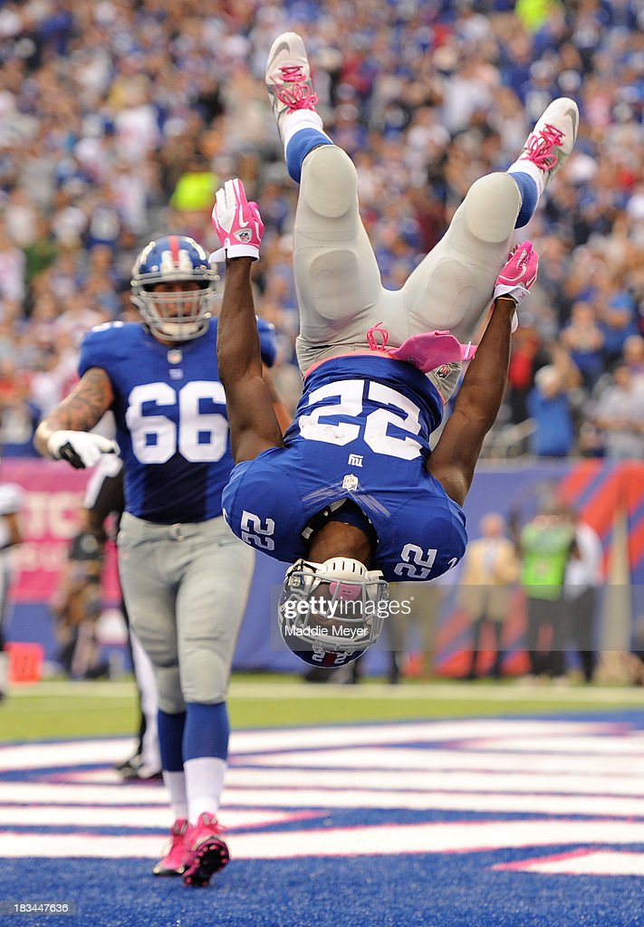 David Wilson #22 of the New York Giants celebrates in the end zone after scoring a touchdown against the Philadelphia Eagles at MetLife Stadium on October 6, 2013 in East Rutherford, New Jersey.