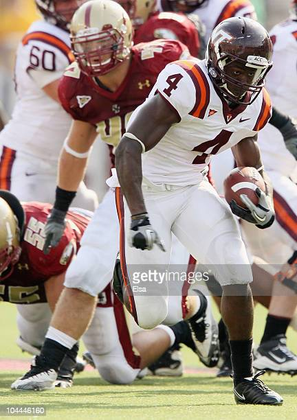 David Wilson of the Virginia Tech Hokies breaks free and carries the ball as Brad Newman of the Boston College Eagles defends on September 25 2010 at...