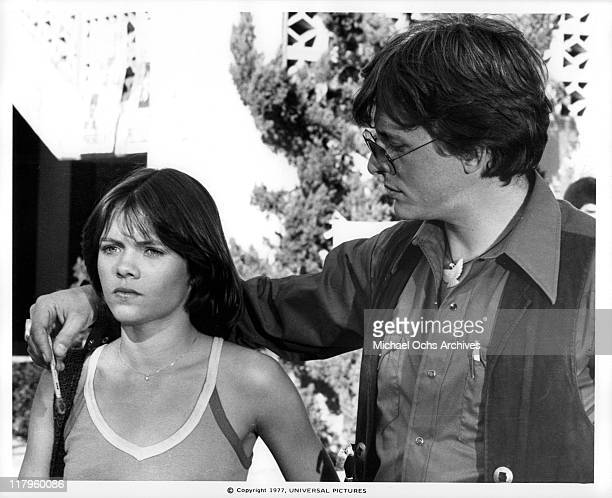 David Wilson putting his hand around Donna Wilkes's shoulder in a scene from the film 'Almost Summer' 1978
