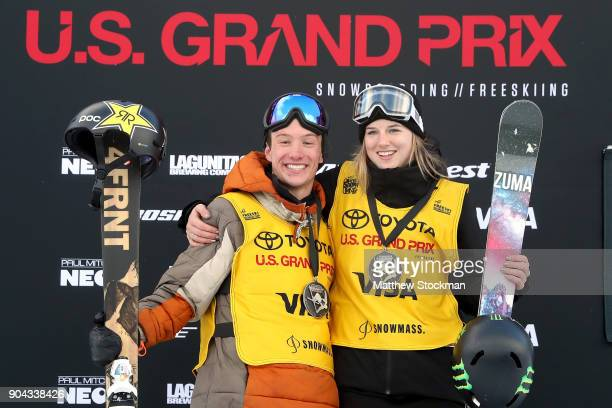 David Wise and Cassie Sharp of Canada pose for photographers wearing their FIS points leader's bib after the Freeski Halfpipe final during the Toyota...