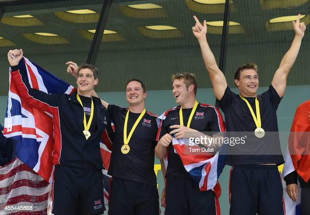 David Wiseman Michael Goody Luke Reeson and Gus Hurst of Great Britain pose for photos with their Gold Medals after the Men's/Women's Open 200m...