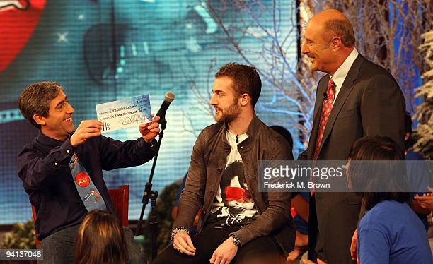 David Wish recording artist Jordan McGraw and Dr Phil McGraw speak during the taping of the Dr Phil television show announcing Little Kids Rock...