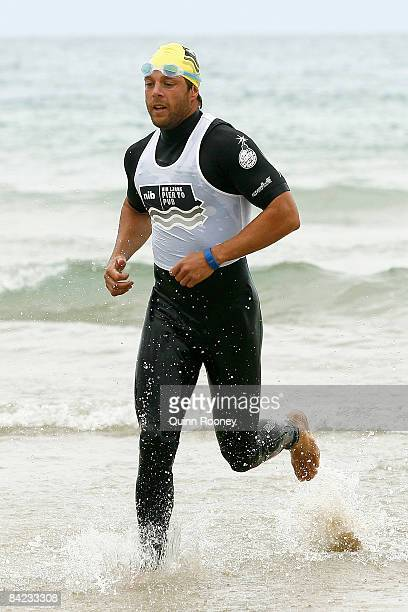 David Wojcinski of the Geelong Football Club runs out of the water during the Lorne Pier To Pub open water swim at Louttit Bay January 10 2009 in...