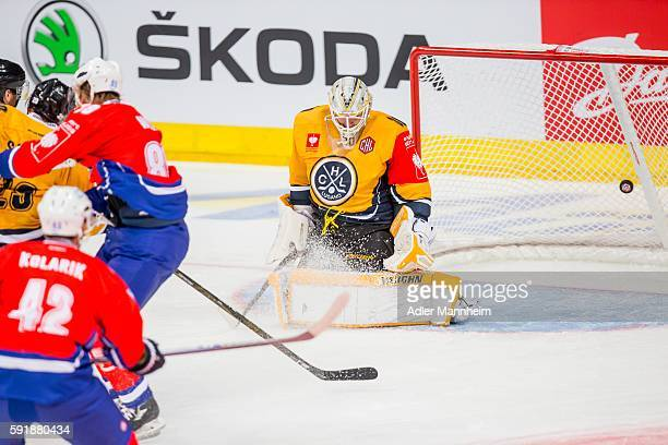 David Wolf of Adler scores 10 against Elvis Merzlikins of HC Lugano during the Champions Hockey League match between Adler Mannheim and HC Lugano at...