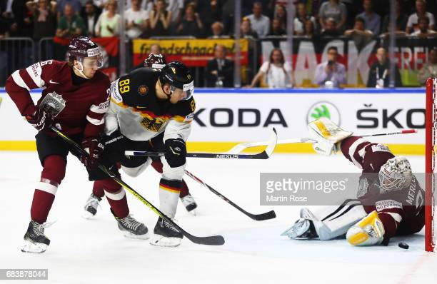 David Wolf of Germany scores a goal during the Germany v Latvia match of the 2017 IIHF Ice Hockey World Championships at Lanxess Arena on May 16,...