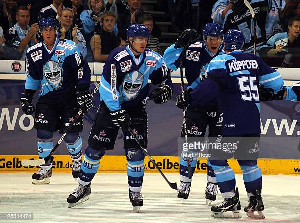 David Wolf of Hamburg celebrate with his team mates his team's opening goal the DEL match between Hamburg Freezers and Adler Mannheim at the O2 World...