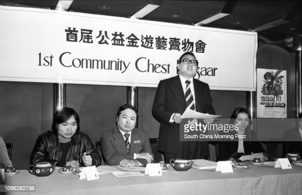 David Wong Executive Director of the Community Chest outlines plans for a charity bazaar at a press conference On his left is Hui Yinfat Chairman of...