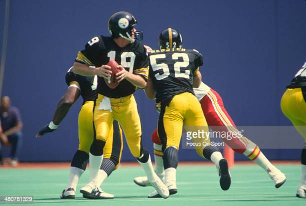David Woodley of the Pittsburgh Steelers drops back to pass against Kansas City Chiefs during an NFL football game September 2 1984 at Three Rivers...