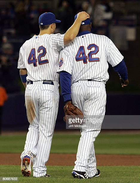 David Wright and Carlos Delgado of the New York Mets celebrate after defeating the Washington Nationals on April 15 2008 at Shea Stadium in the...