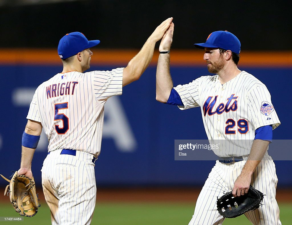 David Wright #5 and Ike Davis #29 of the New York Mets celebrate the win on July 23, 2013 at Citi Field in the Flushing neighborhood of the Queens borough of New York City.The New York Mets defeated the Atlanta Braves 4-1.