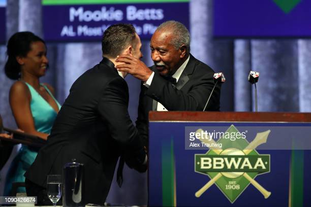 David Wright hugs Cleon Jones of the 1969 Mets winners of the Willie Mickey the Duke Award during the 2019 Baseball Writers' Association of America...