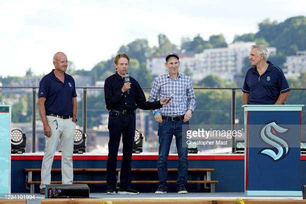 David Wright, Jerry Bruckheimer and Andy Jassy of the Seattle Kraken announce a pick during the 2021 NHL Expansion Draft at Gas Works Park on July...