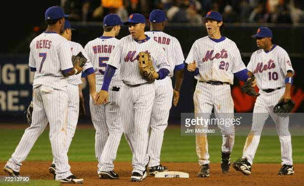 David Wright Jose Valentin Carlos Beltran Jose Reyes Endy Chavez Shawn Green and Carlos Delgado of the New York Mets celebrate after defeating the St...