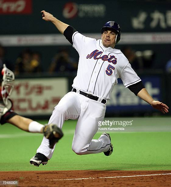 David Wright of New York Mets is touched out at homebase by Catcher Tomoya Satozaki of Chiba Lotte Marines during the Aeon All Star Series Day 5 MLB...