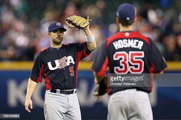 David Wright of Team USA celebrates with teammate Eric Hosmer after defeating Team Italy 6 to 2 after the World Baseball Classic First Round Group D...