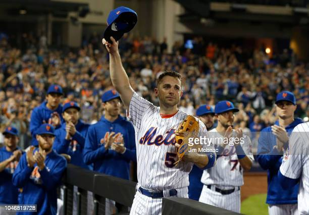 David Wright of the New York Mets acknowledges the crowd as he is removed from the final game of his career during the fifth inning against the Miami...