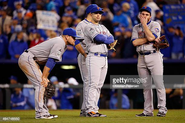 David Wright of the New York Mets and Daniel Murphy of the New York Mets react in the eighth inning against the Kansas City Royals in Game Two of the...