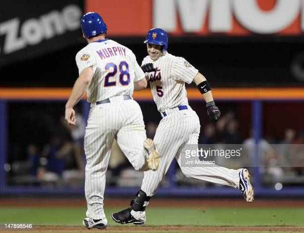 David Wright of the New York Mets celebrates his game winning hit against the Philadelphia Phillies with teammate Daniel Murphy at Citi Field on July...
