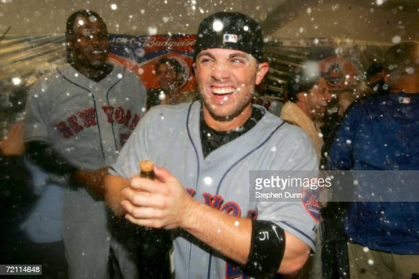 David Wright of the New York Mets celebrates in the locker room after the Mets won 9-5 during Game Three of the National League Division Series...