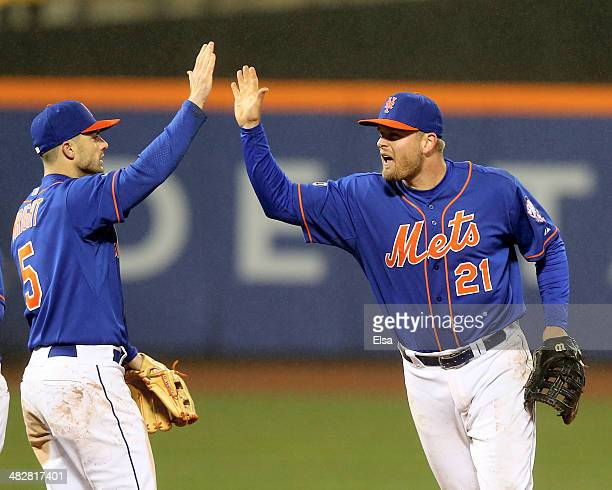 David Wright of the New York Mets celebrates the win with Lucas Duda after the game against the Cincinnati Reds on April 4, 2014 at Citi Field in the...