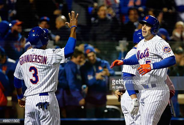 David Wright of the New York Mets celebrates with Curtis Granderson after hitting a two run home run in the first inning against the Kansas City...