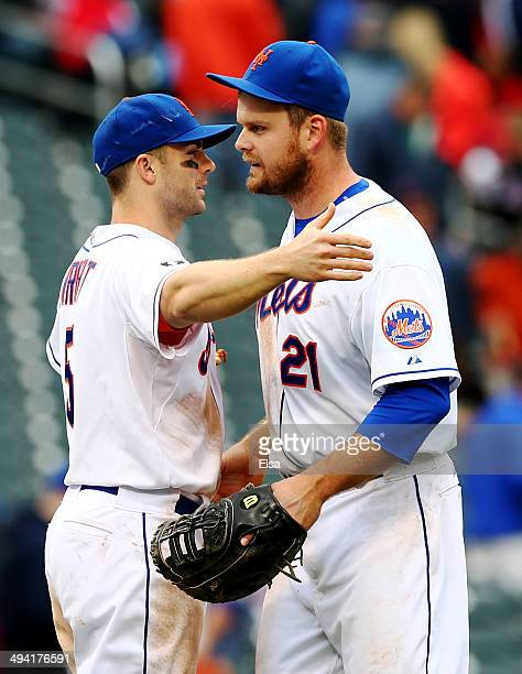 David Wright of the New York Mets celebrates with teammate Lucas Duda after the 5-0 win over the Pittsburgh Pirates on May 28, 2014 at Citi Field in...