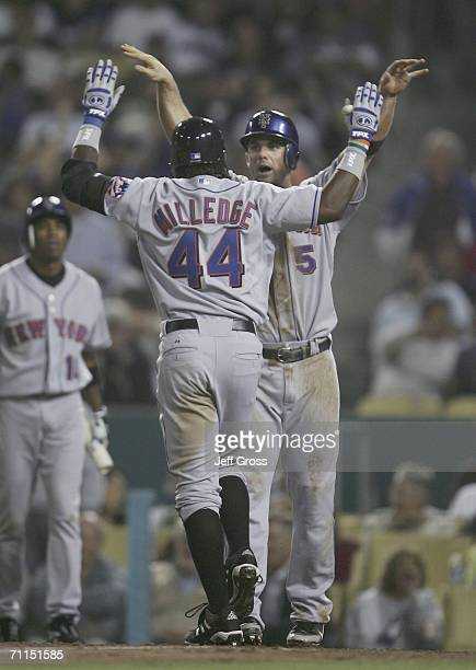 David Wright of the New York Mets congratulates teammate Lastings Milledge on hitting a tworun home run in the seventh inning against the Los Angeles...