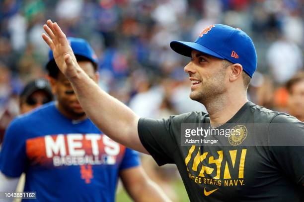 David Wright of the New York Mets gestures to fans as he walks into the dugout after defeating the Miami Marlins at Citi Field on September 30 2018...