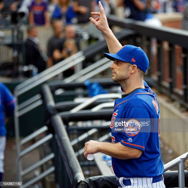 David Wright of the New York Mets gestures to the crowd as he walks into the dugout after defeating the Miami Marlins at Citi Field on September 30...