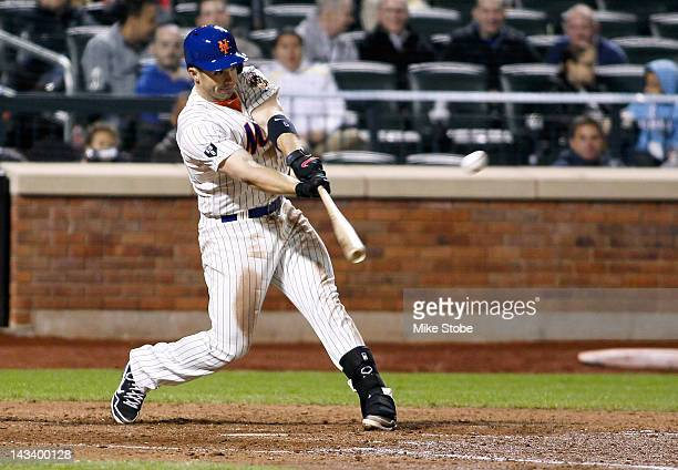 David Wright of the New York Mets hits a tworun homerun in the sixth inning against the Miami Marlins at Citi Field on April 25 2012 in the Flushing...