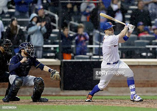 David Wright of the New York Mets hits a walk off single to win the game as Jonathan Lucroy of the Milwaukee Brewers defends in the ninth inning at...