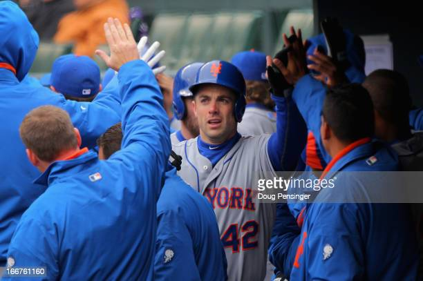 David Wright of the New York Mets is welcomed back to the dugout after his two run homerun against the Colorado Rockies to give the Mets a 20 lead in...