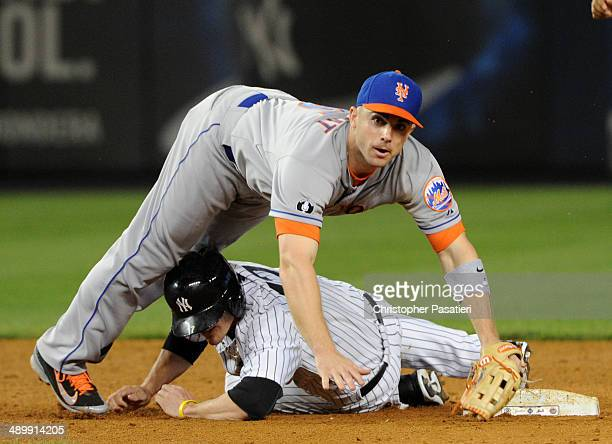 David Wright of the New York Mets looks on after completing a game ending double play over Brendan Ryan of the New York Yankees during the bottom of...