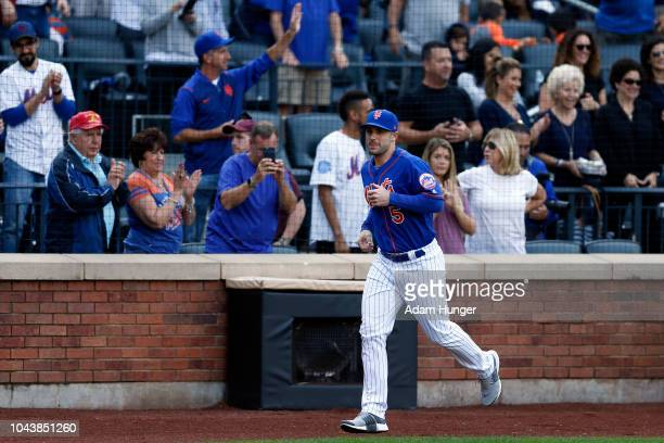 David Wright of the New York Mets runs across the field during the fourth inning against the Miami Marlins at Citi Field on September 30 2018 in the...