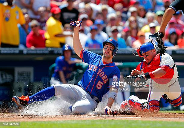 David Wright of the New York Mets scores on an infield popup by Chris Young before Carlos Ruiz of the Philadelphia Phillies can apply the tag during...