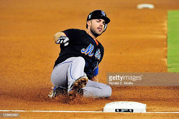 David Wright of the New York Mets slides into third base during a MLB game against the Florida Marlins at Sun Life Stadium on September 5 2011 in...