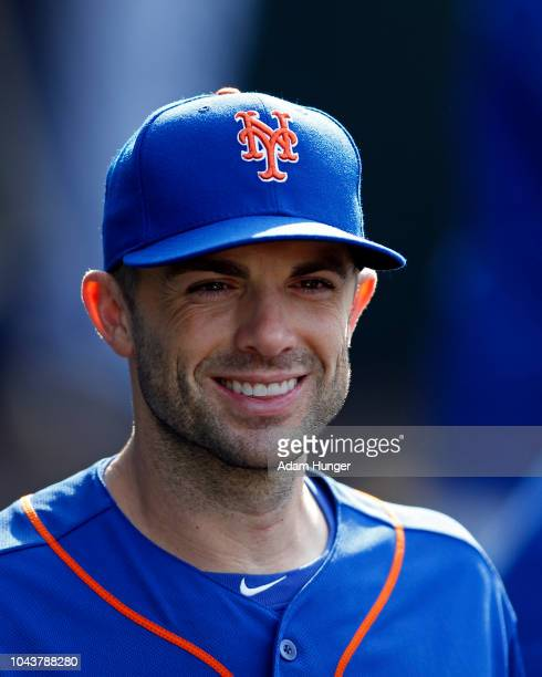 David Wright of the New York Mets smiles in the dugout during the fourth inning against the Miami Marlins at Citi Field on September 30 2018 in the...