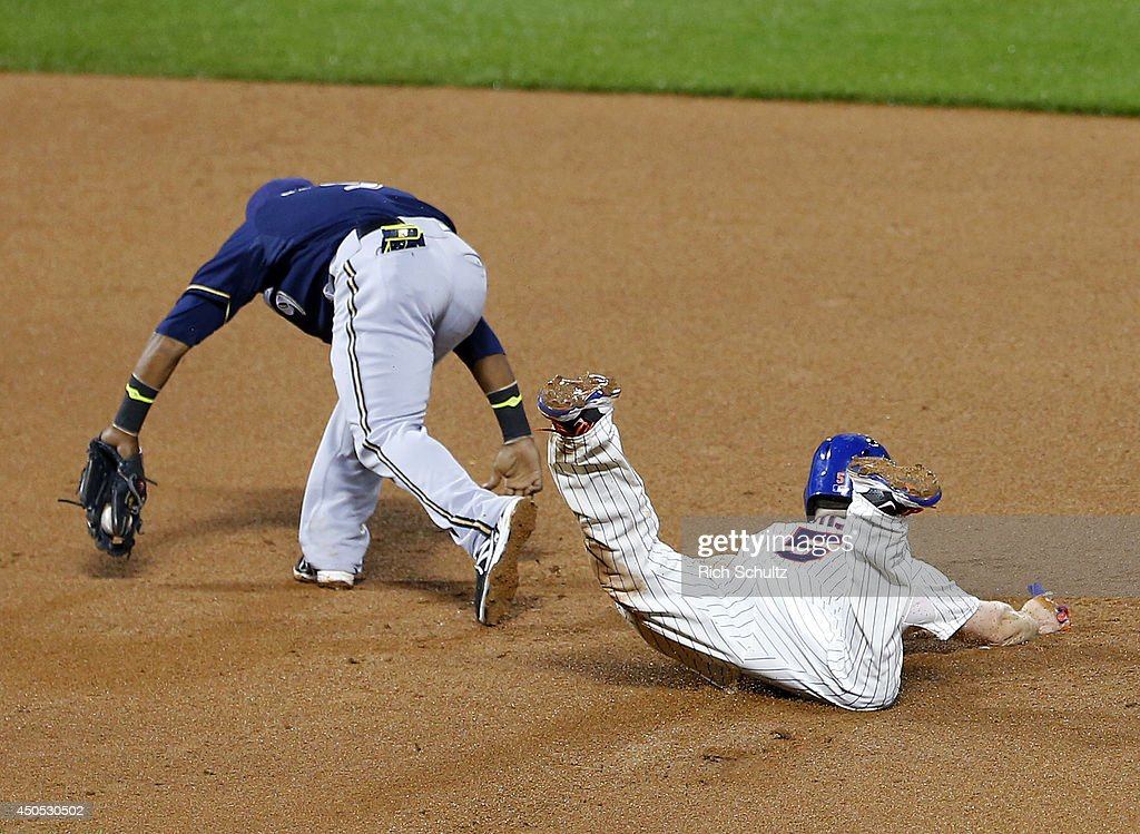 David Wright #5 of the New York Mets steals second base as shortstop Jean Segura #9 of the Milwaukee Brewers reaches for the ball during the 11th inning on June 12, 2014 at Citi Field in the Flushing neighborhood of the Queens borough of New York City.