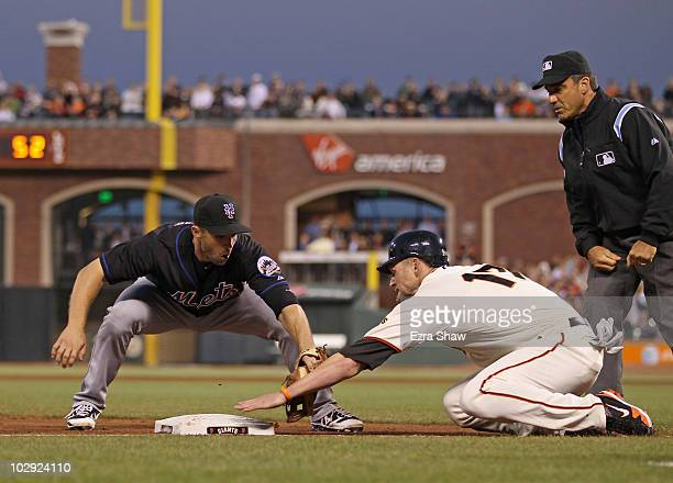David Wright of the New York Mets tags out Aubrey Huff of the San Francisco Giants after Huff slide past third base in the sixth inning at AT&T Park...