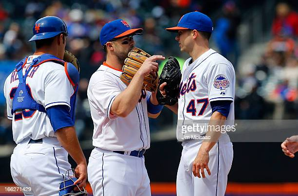 David Wright of the New York Mets talks with teammate pitcher Aaron Laffey during a game against the Miami Marlins at Citi Field on April 7 2012 in...