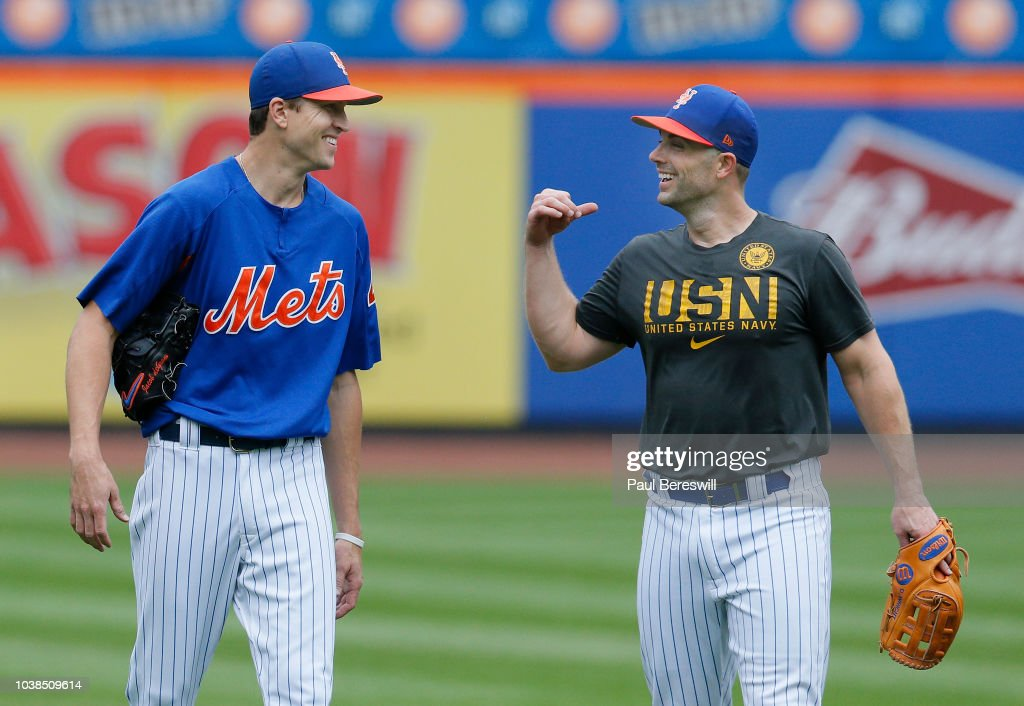 David Wright #5 of the New York Mets, who has not played for the Mets for over two years because of back and neck medical problems and is looking to make a return to the Mets, talks with Jacob deGrom #48 on the field as he walks off after playing in a simulated game before an MLB baseball game against the Philadelphia Phillies on September 8, 2018 at Citi Field in the Flushing neighborhood of the Queens borough of New York City. Mets won 10-5.