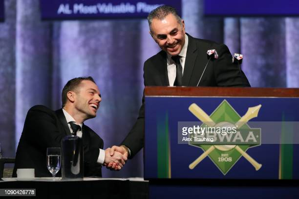 David Wright of the New York Mets winner of the Joe DiMaggio Toast of the Town award shakes hands with John Franco during the 2019 Baseball Writers'...