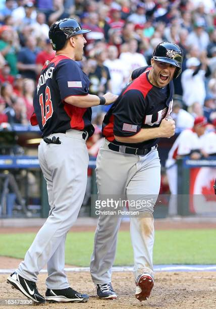David Wright of USA celebrates with Willie Bloomquist after scoring against Canada during the eighth inning of the World Baseball Classic First Round...