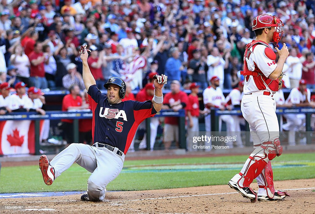 David Wright #5 of USA slides in to score a run past catcher Chris Robinson #30 of Canada during the World Baseball Classic First Round Group D game at Chase Field on March 10, 2013 in Phoenix, Arizona. USA defeated Canada 9-4.