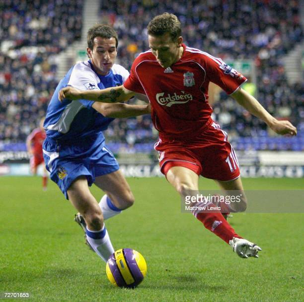 David Wright of Wigan tries to stop Craig Bellamy of Liverpool during the Barclays Premiership match between Wigan Athletic and Liverpool at the JJB...